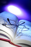 Book and spectacles. Spectacles on open printed book Royalty Free Stock Image