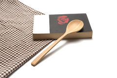 Book and spoon with kitchen towel Royalty Free Stock Photography