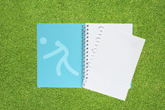Book with Sport volley ball. Icon on grass background Royalty Free Stock Images