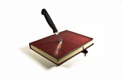 Book Stabbed By Knife Stock Photography