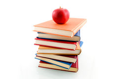 Book stack with an apple. Isolated on white background stock photos