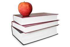 Book stack with an apple isolated on white backgro. Und Royalty Free Stock Photos