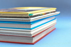 Book stack close up. With blue background Stock Image