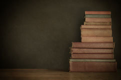 Book Stack on Desk with Chalkboard Background - Vintage Style Stock Photography