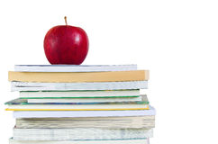 Book stack with fresh red apple on top Royalty Free Stock Image