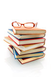 Book stack with glasses. Isolated on white background royalty free stock photography