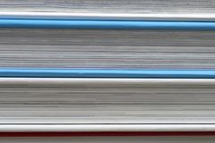 Book, stack of hardback books on table. Top view. Royalty Free Stock Image