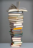Book stack with open book Stock Photo