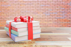 Book stack with ribbon Stock Images