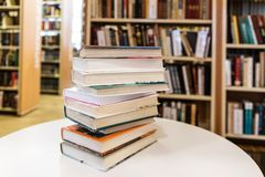 Book Stack On White Desk In The Library Room stock photography