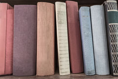 Book stack on wood shelf. Old book vertical stack on wood shelf Royalty Free Stock Photo