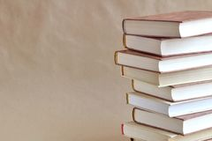 Stacked books on a beige background. royalty free stock photo