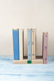 Book stacking, hardback books on wooden table. Back to school. Copy space for text.  stock photos