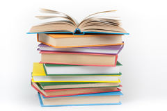 Book stacking. Open book, hardback books on white background. Back to school. Copy space for text. Stock Photography