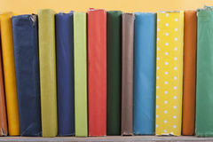 Book stacking. Open hardback books on wooden table and yellow background. Back to school. Copy space for ad text.  royalty free stock photos