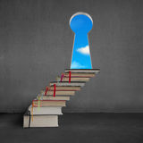 Book stairs to key shape door with blue sky outside Stock Photography