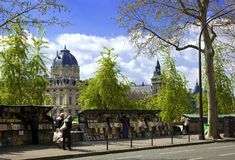 Book stalls along the Seine, Paris, France. Book stalls line the Right Bank of the Seine with the Palais de Justice in the background Stock Photo
