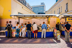 Book stalls in Arbat street of Moscow. Russia, on Sunday, July 13, 2014. Vakhtangov Theatre and fountain Turandot in Arbat street of Moscow, Russia, on Sunday Royalty Free Stock Image