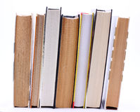 Book are standing upright in a row. On white background Royalty Free Stock Photo