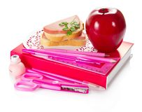 Book, stationery, sandwich with sausage and apple Stock Photo