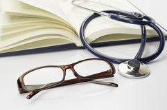 Book, Stethoscope and Glasses - Conceptual Royalty Free Stock Images