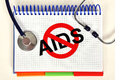 Book with stop aids symbol Royalty Free Stock Photography