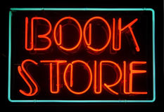 Book store. A glowing blue and red neon book store sign Royalty Free Stock Images