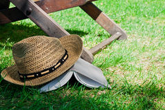 Book and straw hat on grass Stock Image