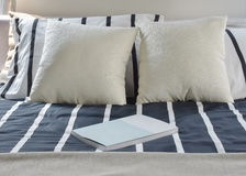Book on striped bedding modern style Royalty Free Stock Images