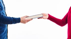 Book swap. Close up portrait of man and women students exchanging books isolated on white. Literature sharing between people. Give to read to a friend as present stock photos