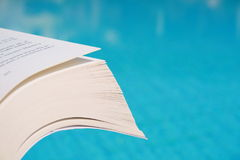 Book and swimming Pool!. The book in front of swimming pool in the summer day Stock Photos