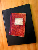 Book of Symbols. This is a picture of a red notebook with the word symbols written in caligraphy on the cover. It would fit right in on the shelf of any serious Royalty Free Stock Photo