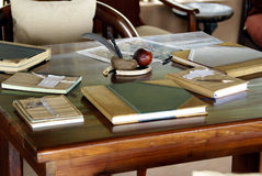 Book Table 01. A book table covered with antique looking books. These are visitors book in a African game lodge Stock Photography