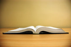 Book on the table. Photo of opened book on the table Royalty Free Stock Photo