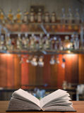 Book on the table in a club. Open book on the table in a night club Royalty Free Stock Photos
