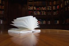 Book on the table with library in the background stock images