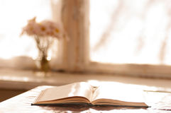 Book on the table near the window Royalty Free Stock Images