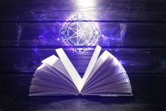 Book on the table out comes light and magic sign Royalty Free Stock Photos