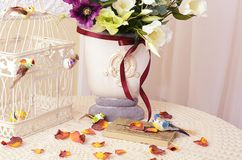 The book on a table with rose petals. The book on a table with rose-petals Stock Image