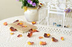 The book on a table with rose petals. The book on a table with rose-petals Royalty Free Stock Images