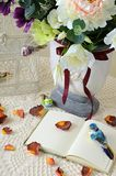 The book on a table with rose petals. The book on a table with rose-petals Royalty Free Stock Photos