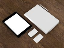 Book, tablet, business cards. On a wooden background High resolution Royalty Free Stock Photo