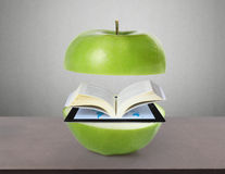 Book and tablet computer. Model and green  apple Royalty Free Stock Photo