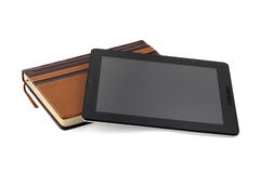 Book tablet PC. Tablet pc and book on a white background Stock Photos
