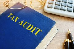 Book about Tax audit and accounting. Stock Photo