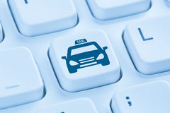 Book taxi cab online internet booking blue computer keyboard Royalty Free Stock Image