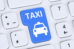 Book a taxi or cab online internet booking computer Stock Photography