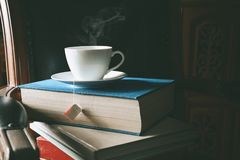 Book and tea on the desk with study. And education concept. vintage tone Stock Photos