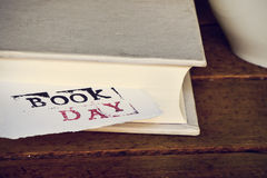 Book and text book day in a piece of paper Royalty Free Stock Images