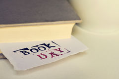Book and text book day in a piece of paper Stock Photos